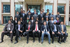 Aman Chugh with faculty members and students